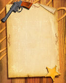 Cowboy Old paper background with gun and sheriff star — Stock Photo