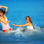 Girls in water — Stock Photo