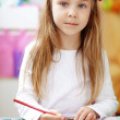 Little kid girl painting — Stock Photo