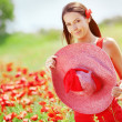 Young woman at poppy field — Stock Photo
