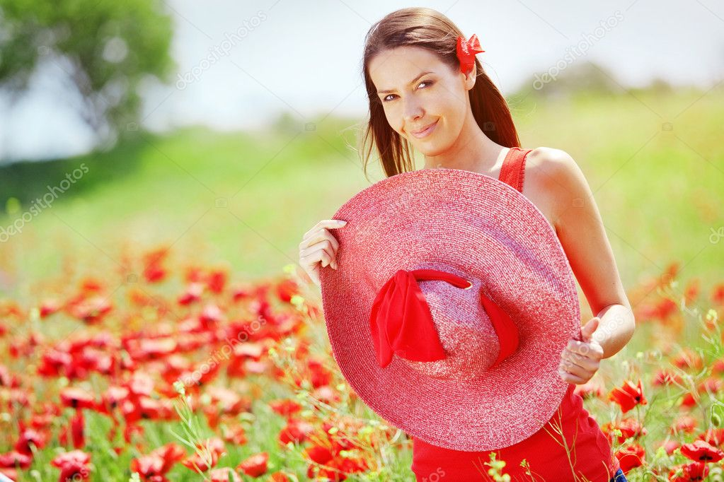 Portrait of young beautiful woman at poppy field — Stock Photo #5748040
