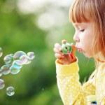 Child starting soap bubbles — Stock Photo #5909609