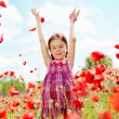 Child at poppy field — Stock Photo