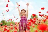Child at poppy field — Stock Photo