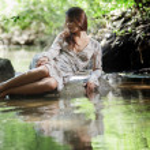 Beautiful woman walking in river — Stock Photo #6022321