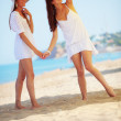 Girls resting at beach — Stock Photo
