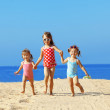 Kids playing at the beach — Stock Photo