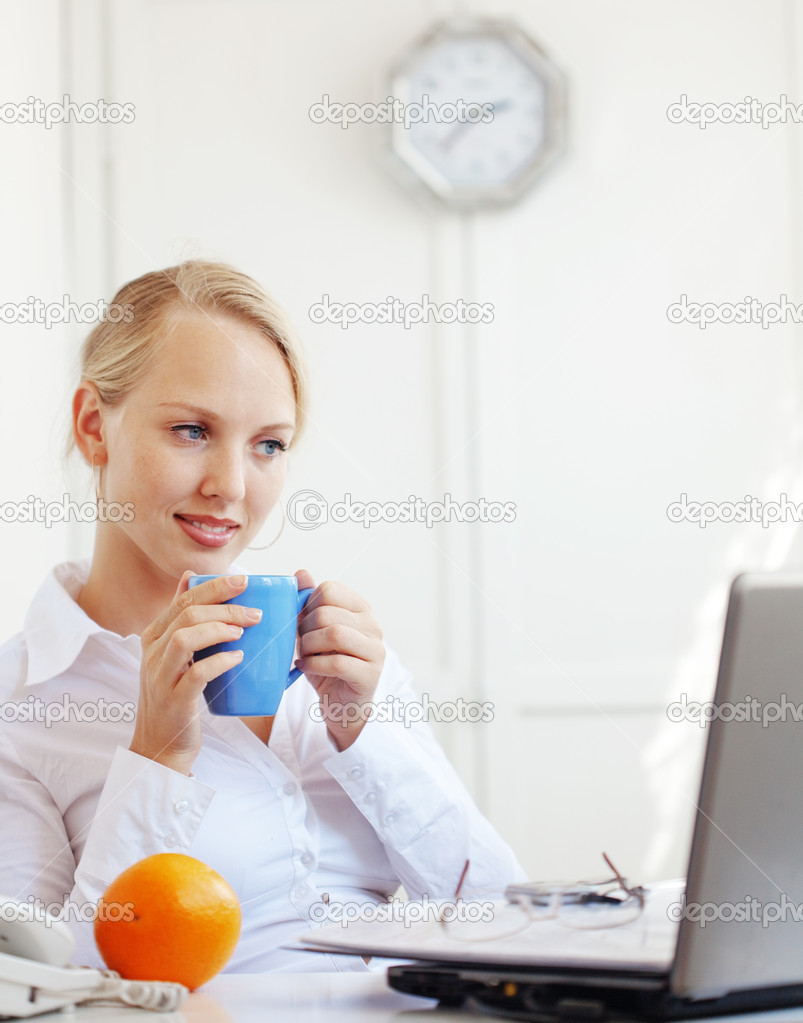 Portrait of a smiling business woman working on her desk  Stock Photo #6190469