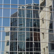 Stock Photo: Office building reflection in another building