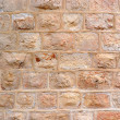 Wall built of rough stone blocks — Stock Photo