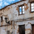 Facade of a very old ruined house - Stock Photo