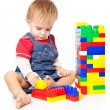 A funny boy is playing with lego — Stock Photo #5480765