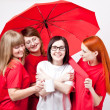 Girls under the umbrella — Stock Photo