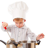 A funny boy is portraying a cook — Stock Photo