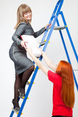 A woman on a stepladder with papers — Stock Photo