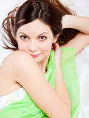 Girl is lying on a bed — Stock Photo