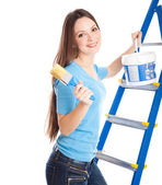 A woman on a stepladder — Stock Photo