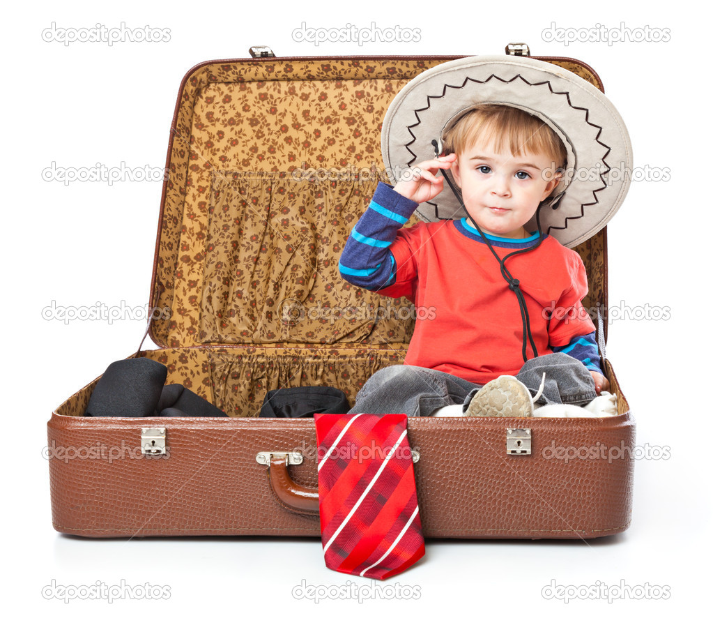 A Funny Boy With Sombrero Is In The Suitcase Stock Photo