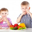 Boys and plates of vegetables and meat — Stok fotoğraf