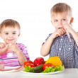 Royalty-Free Stock Photo: Boys and plates of vegetables and meat