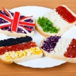 Sandwiches with flags of four countries — Stock Photo #5652782
