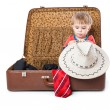 Stock Photo: A funny boy with sombrero is in the suitcase