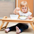 A small girl is eating - Stock Photo
