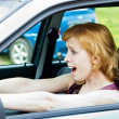 A scared woman behind the wheel - Stock Photo