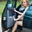 A beautiful woman is sitting in a car — Stock Photo #5686402