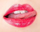Woman is licking her lips. — Stock Photo