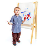 A boy is drawing on a blackboard. Isolated on a white background — Stock Photo