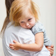 A mother is holding a sick girl. — Stock Photo #6010474