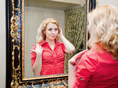 Reflection of young woman in a mirror — Stock Photo