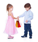 A boy is giving the gift to a girl — Stockfoto