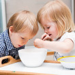 Funny children are eating dessert — Stock Photo #6136714