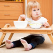 A small girl is eating — Stock Photo