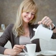 Woman is in cafe - Stock Photo