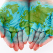 Painted world on hands — Foto de stock #6136837