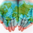 Painted world on hands - Stock Photo