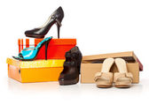 Fashion shoes on the boxes — Stock Photo