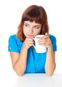 A smiling girl is drinking a coffee — Stock Photo