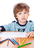 A small boy is drawing — Stock Photo