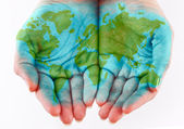 Painted world on hands — Stock Photo