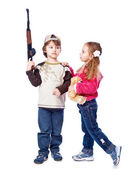 A girl is kissing a boy with the gun — Stock Photo