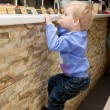 A boy is climbing on the bar - Stock Photo
