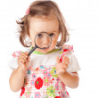 A little girl is looking through the loupe — Stock Photo #6267841