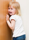 Naughty child is standing in the corner — Stock Photo