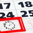 Close up of calendar page with clock — Stock Photo