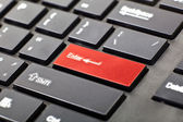 A keyboard with red button — Stockfoto