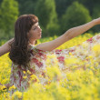 Woman dancing in field - Foto de Stock